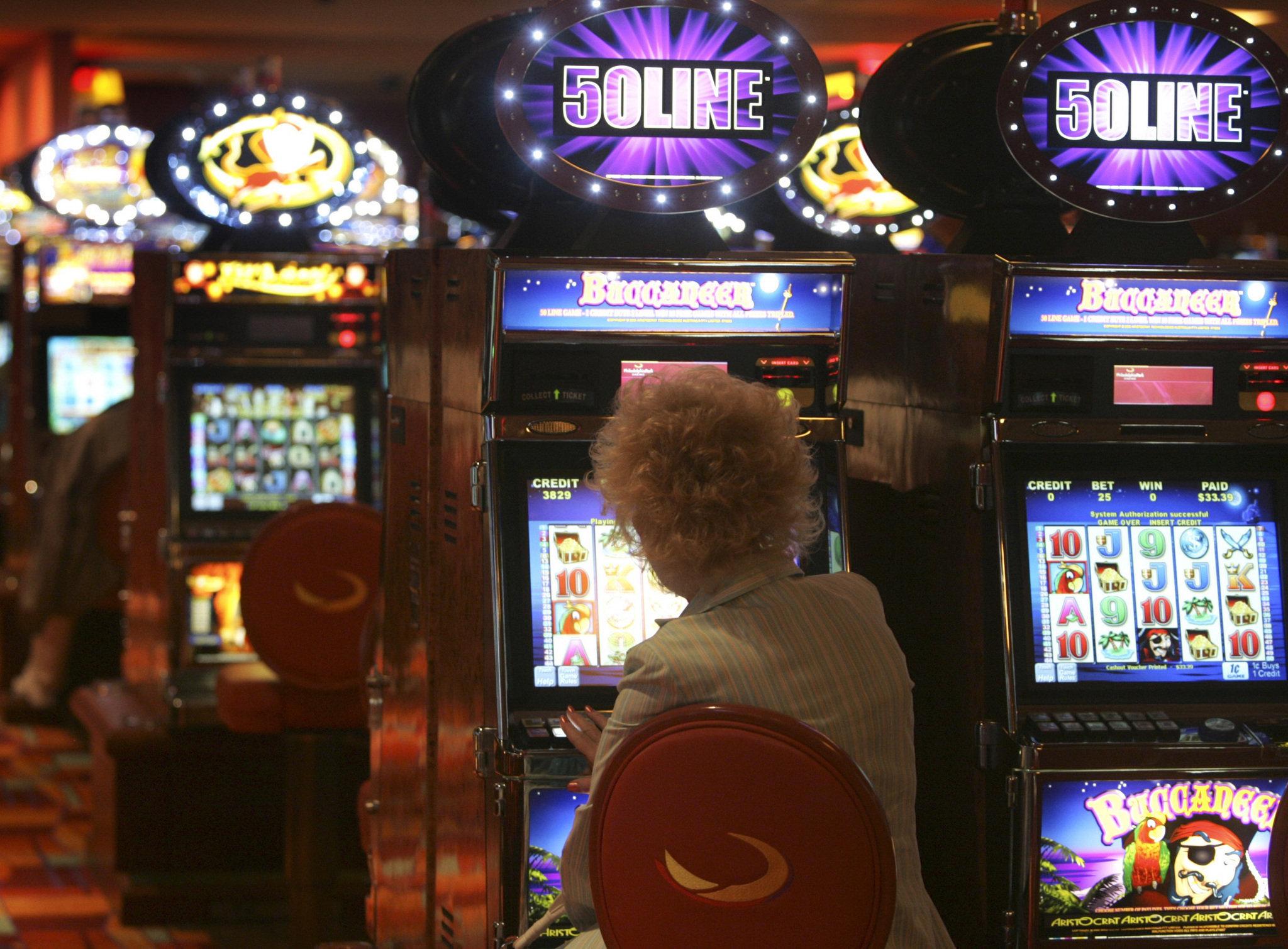 Woman try to win jackpot at slot machine
